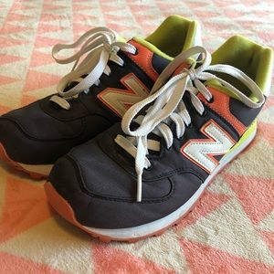 Gray pink and neon yellow New Balance sneakers